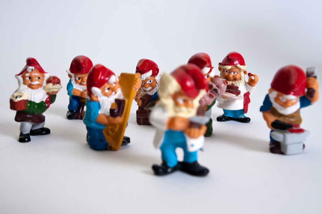 A set of colorful KInder working gnomes captured in macro. The attention is focused on the construction worker, the inn keeper, the farmer, the chef and the potter.